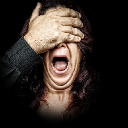 Woman screaming with a hand covering her eyes