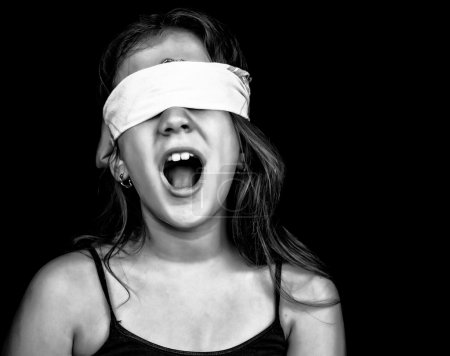 Screaming girl being abused and blindfolded