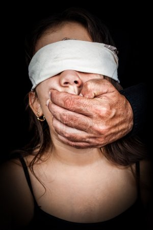 Small girl being silenced and blindfolded