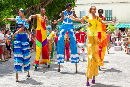 Dancers on stilts at a carnival in Old Havana