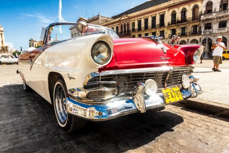 Vintage Ford Fairlane in front of the Capitol in Havana
