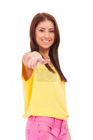 Photo for Young female pointing at you - Portrait of an attractive young woman pointing her finger. Isolated on white background - Royalty Free Image