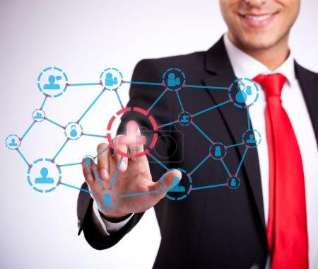 Businessman pressing social network buttons