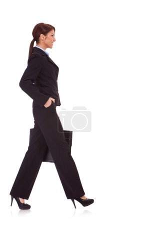 Business woman walking with a briefcase