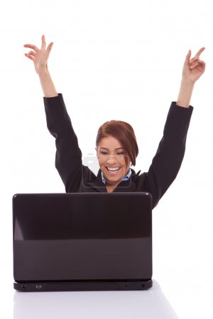 Business woman in office jubilates at desk