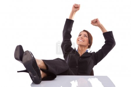 Relaxed and winning business woman sitting