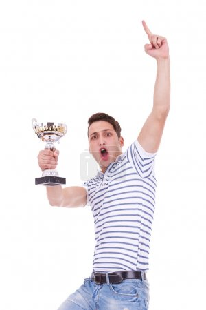 Young casual man winning a trophy