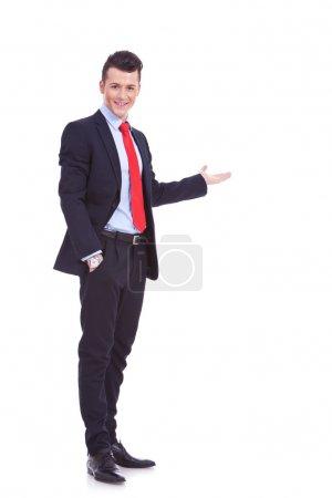 Happy business man giving presentation