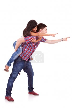 Young man with his girlfriend pointing towards something