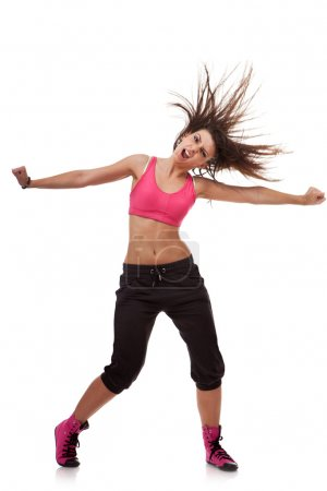 Young dancer yelling with arms stretched out