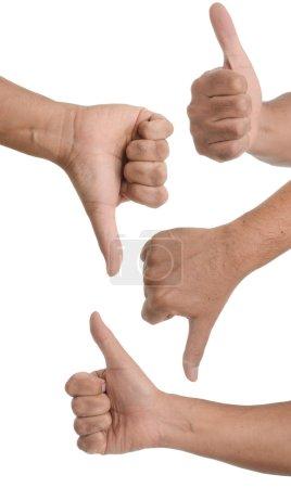 Photo pour Gestes de la main montrant les pouces vers le haut ou vers le bas - main mâle asiatique. isolé sur blanc - image libre de droit