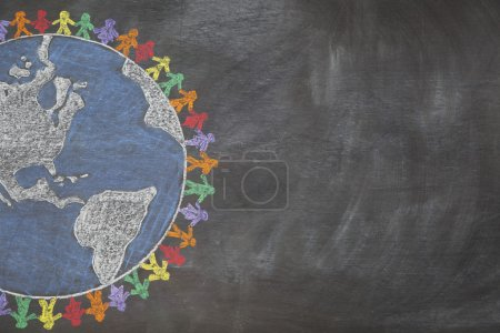 Photo for A hand drawn chalkboard shows multi-ratial holding hands around the world to show care for the earth, peace, and unity. Shown off centered for copy-space. - Royalty Free Image