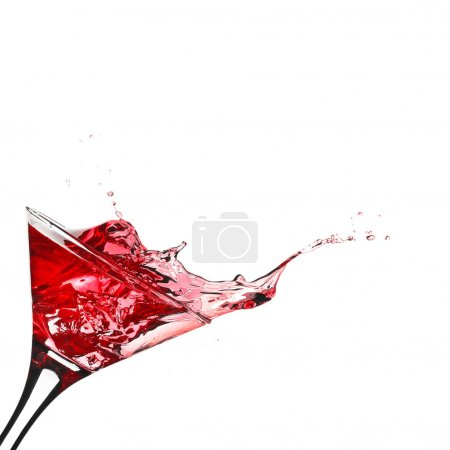Red cocktail with splash isolated on white...