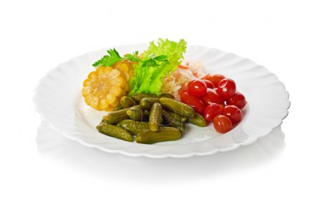 Pickled vegetables of tomato, cucumber, cabbage isolated