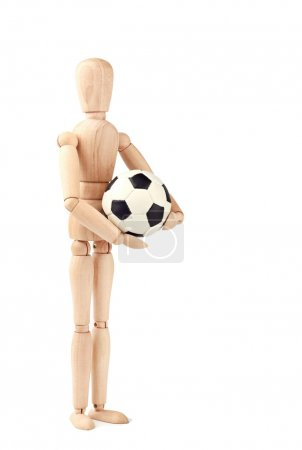 Wooden doll with soccer ball isolated