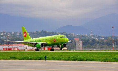 Boeing-737-800, passenger airliner of S7 airlines («Siberia») on the platform of the International Sochi airport on August 16, 2012 in Sochi, Russia