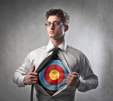 Photo for Young businessman showing a target under his shirt - Royalty Free Image