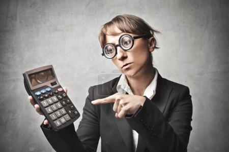 A businesswoman is calculating some business....