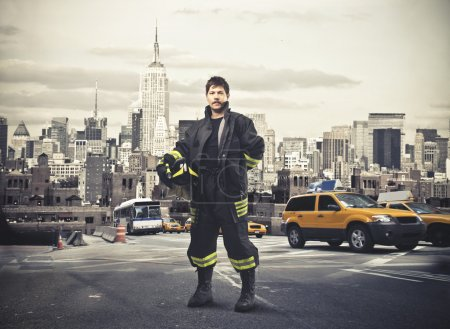 Photo for A New York's fireman in a parking. - Royalty Free Image