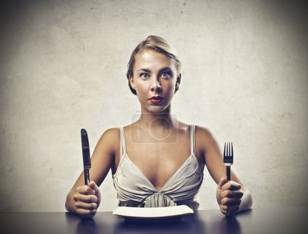 Photo for A cute girl blonde is ready to eat. - Royalty Free Image