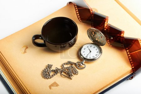 Photo for Vintage clock with chain and filmstrip and coffee cup - Royalty Free Image