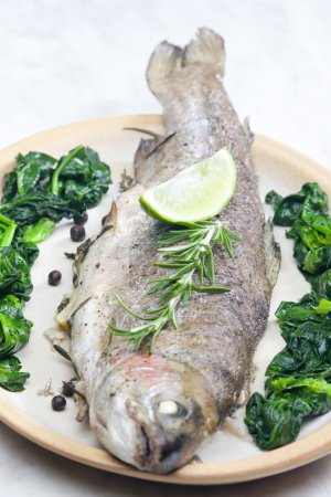 Bream baked with Italian herbs and fried spinach
