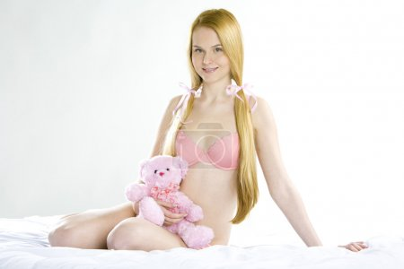 Photo for Woman wearing underwear with teddy bear - Royalty Free Image