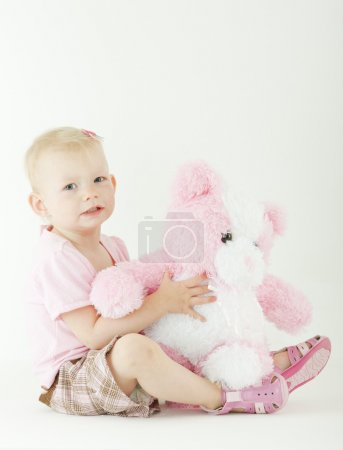 Photo for Sitting toddler with a teddy bear - Royalty Free Image