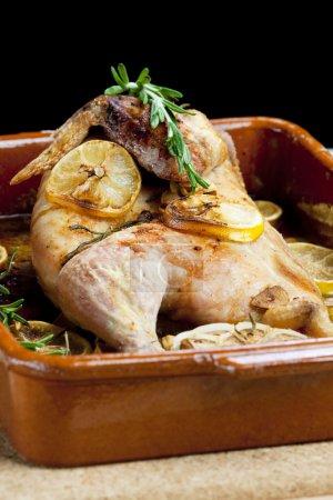 Chicken baked on lemons