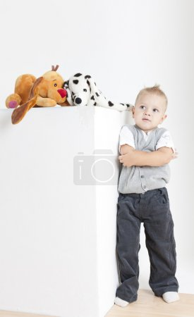 Photo for Standing toddler with toys - Royalty Free Image