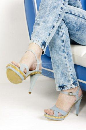 Detail of woman wearing denim summer shoes