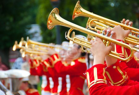 Photo for Girl Brass Band in red uniform performing - Royalty Free Image