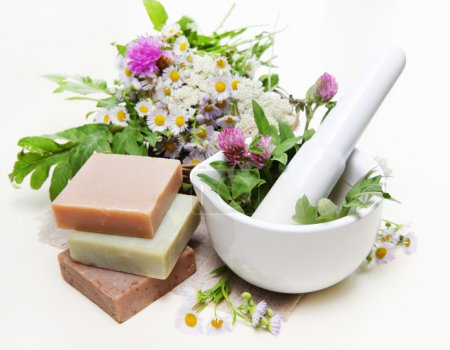 Photo for Spa Composition with Herbs, Mortar and Homemade Soap - Royalty Free Image
