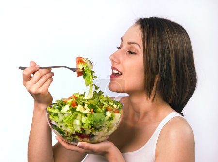 Photo for Young woman eating healthy salad - Royalty Free Image