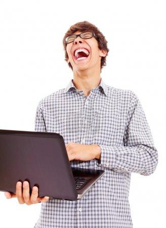 Photo pour Jeune homme lisant quelque chose sur l'ordinateur portable et riant bruyamment à elle. isolé sur fond blanc, masque inclus - image libre de droit