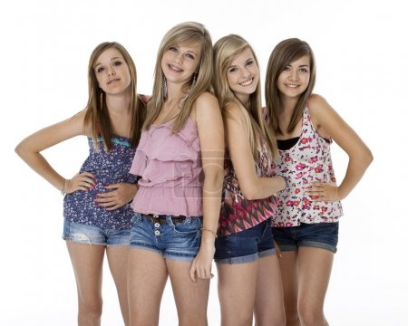 Photo for Four teenage girls in summer clothes standing, isolated on white. - Royalty Free Image