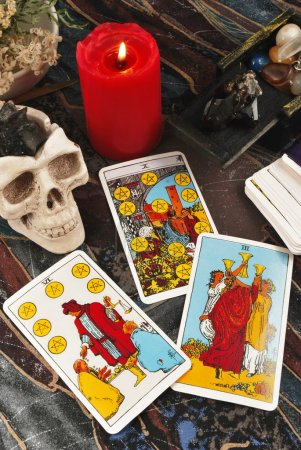 Tarot cards with burning candle session of black magic