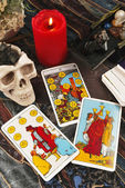 Tarot cards with burning candle