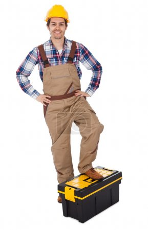Portrait of repairman standing on toolbox