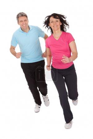Mature fitness couple running