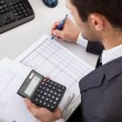 Successful accountant working with financial data ...