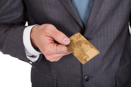 Successful businessman holding credit card