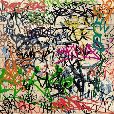 Photo pour Un mur avec beaucoup de graffitis - image libre de droit