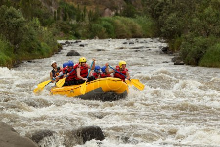 Photo for Group Of Mixed Tourist Men And Women With Guided By Professional Pilot On Whitewater River Rafting In Ecuador - Royalty Free Image
