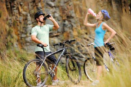 Mountain bike couple drinking