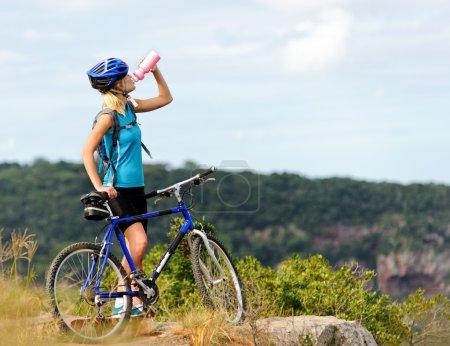 Mountain bike girl drinking
