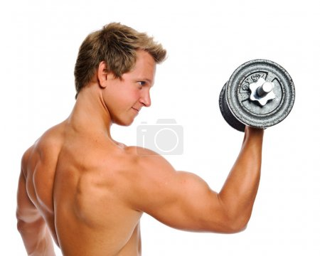 Photo for Bare chested athelete doing bicep exercises in studio - Royalty Free Image
