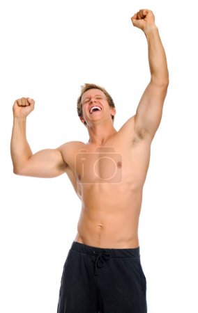 Excited athlete raises his arms for victory