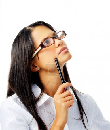 Hispanic woman with glasses thinking with pen
