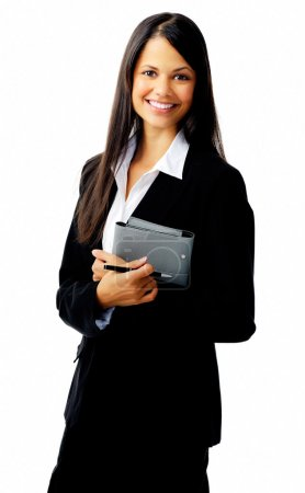 Photo for Businesswoman standing with organizer diary and smiling - Royalty Free Image